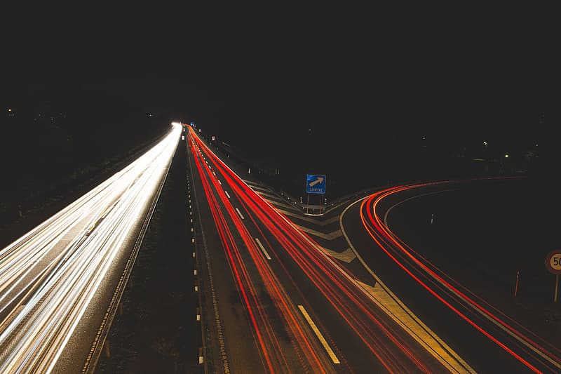 Long exposure photography of cars on road