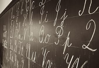 Black chalk board with alphabet letters