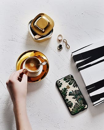 Coffee beside iPhone