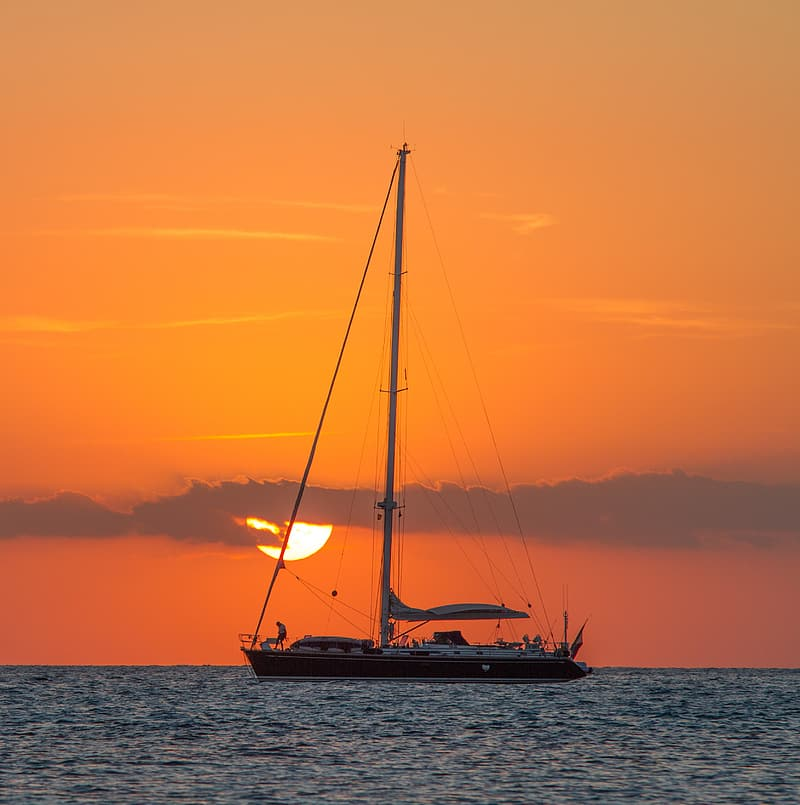 Sailing boat on body of water during golden hour