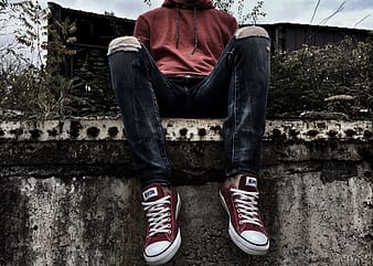 Person sitting on concrete