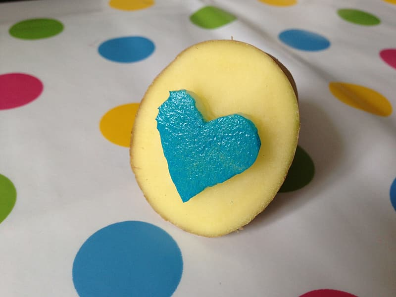 Yellow heart shaped ornament on white and blue polka dot textile