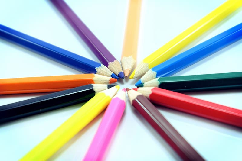 Selective focus photography of multicolored coloring pencils