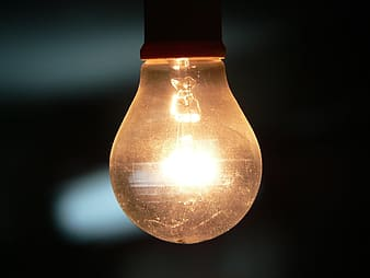 Yellow light bulb against gray background