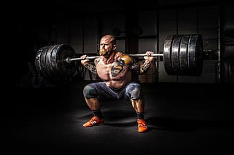 Man lifting adjustable barbells