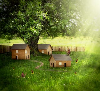 Closeup photography of three miniature houses