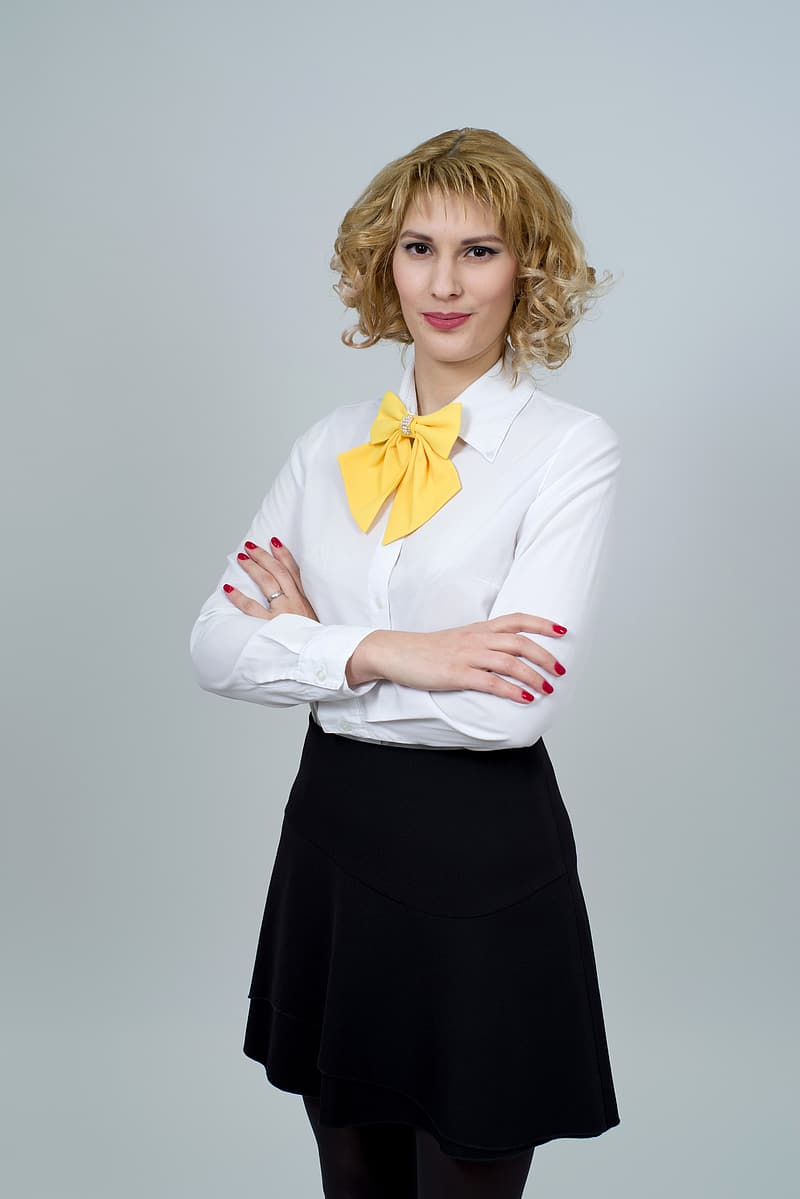 Woman in white dress shirt with black skirt