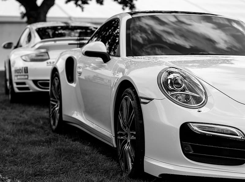 Grayscale photography of two coupes