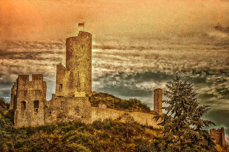 Gray concrete castle on top of hill