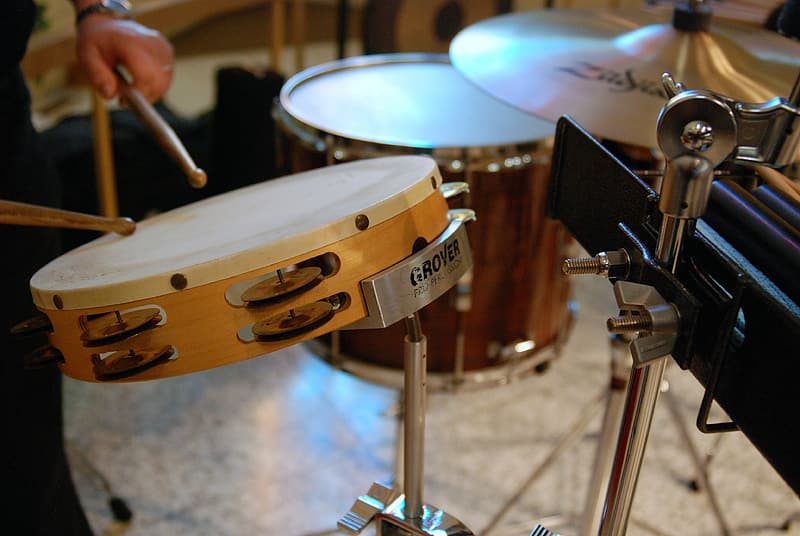 Person playing tomtom drum