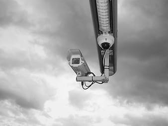 Grayscale photo of surveillance cameras