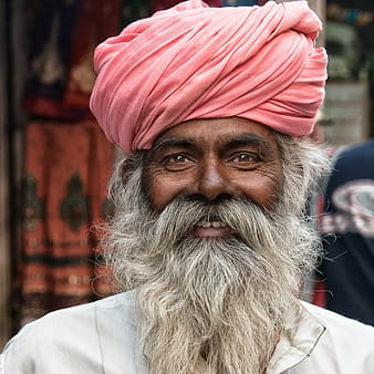 Focused photo of man wearing red turban and shirt