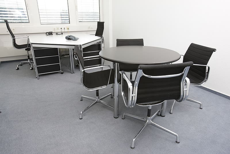 Round black table with four chairs set