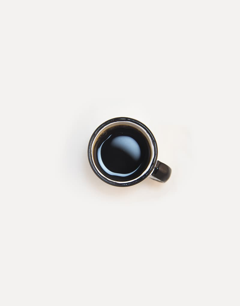 Cup of coffee on white surface