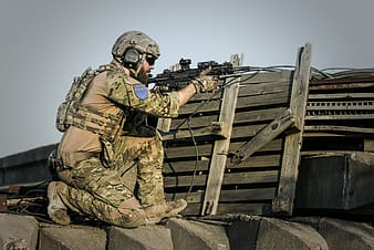 Soldier holding black sniper rifle