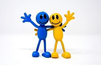 Yellow and blue smiley stick man figures