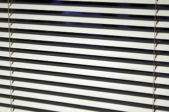 Closeup photo of white window blind