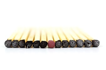 Safety matches arrange respectively on white surface
