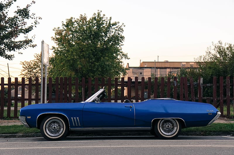 Blue coupe parked on street