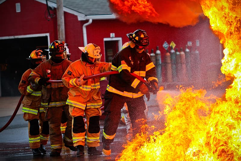Four firefighters fighting fire