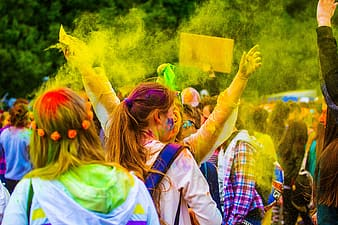 Holi festival walking on street during daytime
