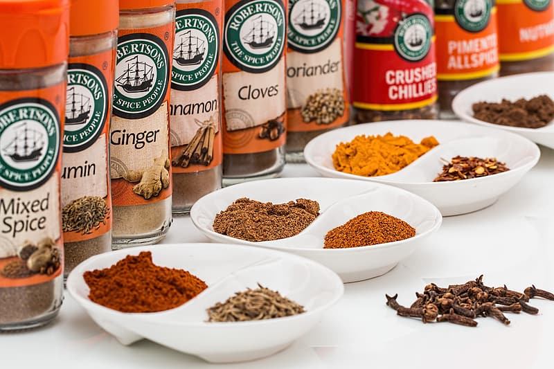 Different spices on plates