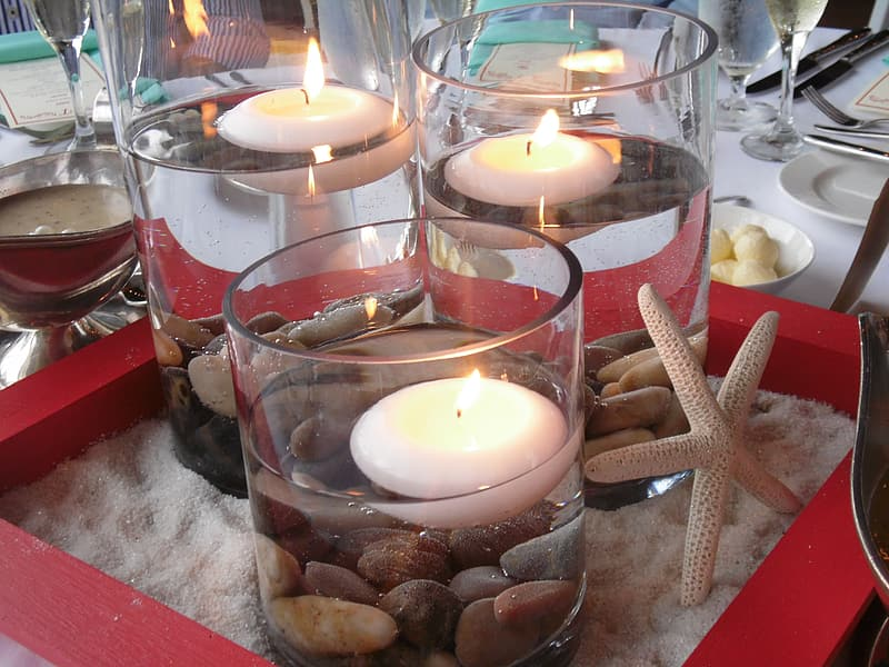 Photo of lighted gel candles on table