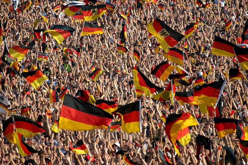 Crowd holding Germany flags