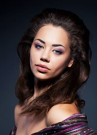 Portait photo of woman in purple top