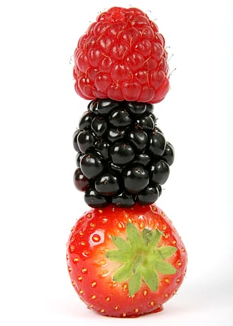 Three berries stacked against white background