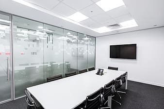 Conference room with black flat screen TV mounted on the wall