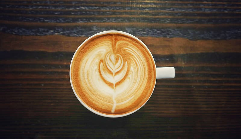 Coffee art in white cup