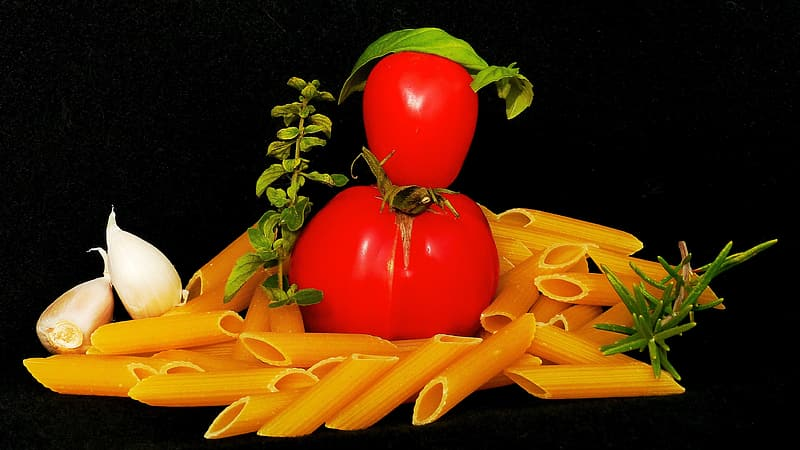 Tomatoes on penne noodles