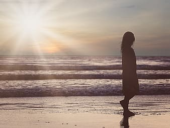 Girl silhouette on seashore photo