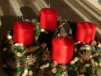 Close-up photography of four red pillar candles
