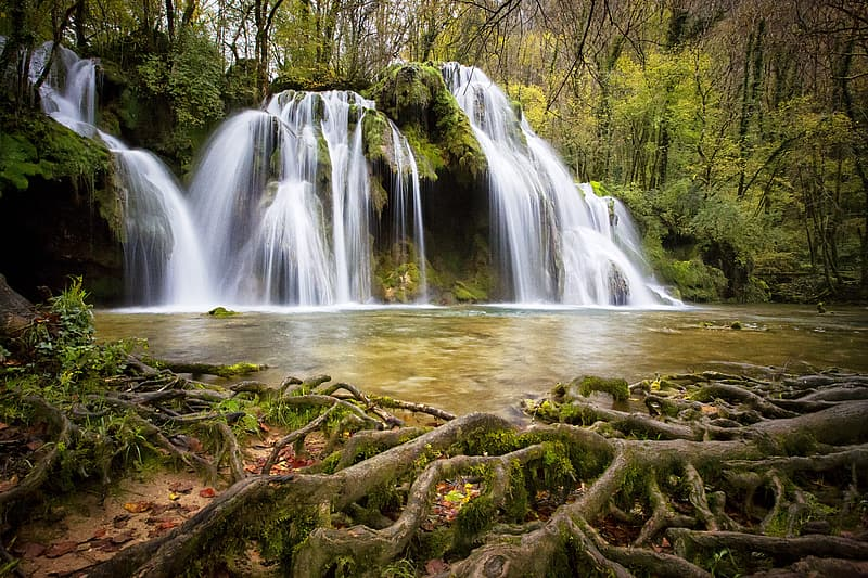 Time lapse photo of waterfalls surrounded by trees