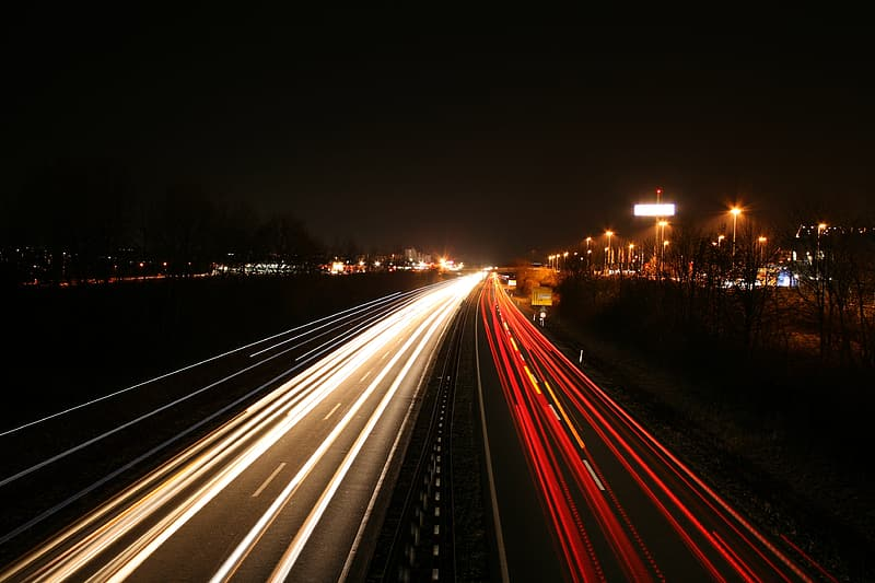 Time lapse photography of cars passing bridge during nighttime