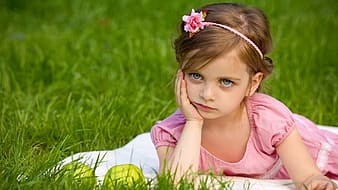 Girl's pink short-sleeved dress and pink hairband taking photo