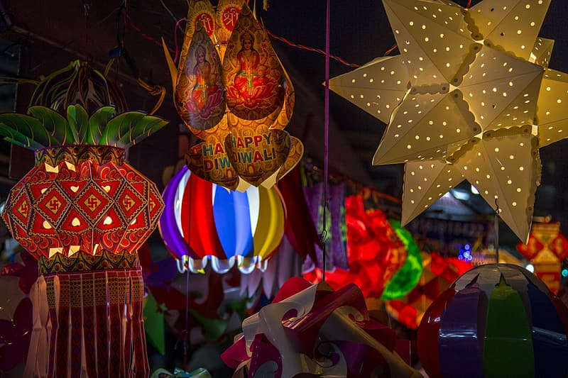 Four assorted-color lighted pinatas