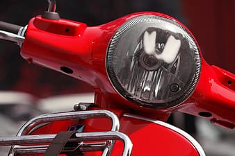 Selective photo of red motorcycle