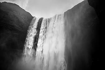 Grayscale low-angle photography of waterfall