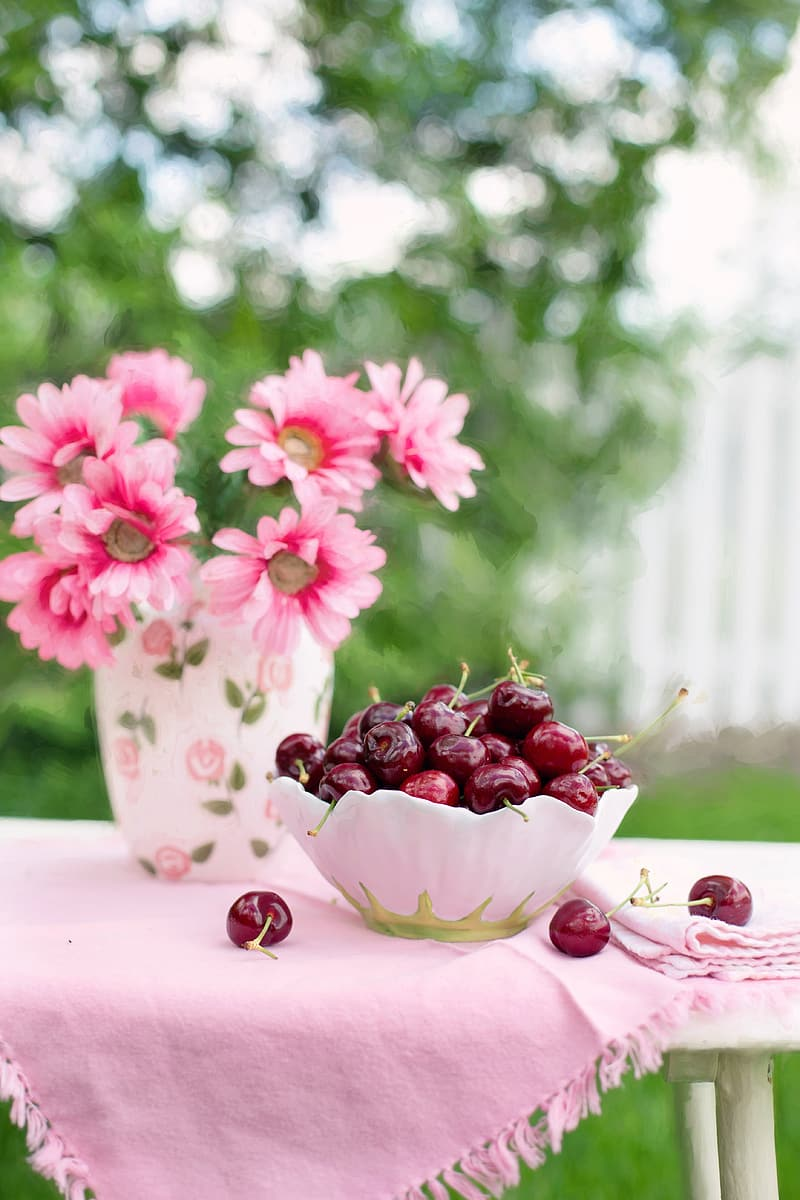 Selective focus photography of bowl of cherries place on table