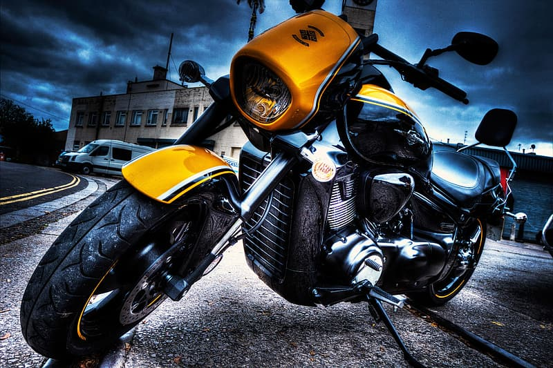 Lowlight photography of yellow and black cruiser motorcycle