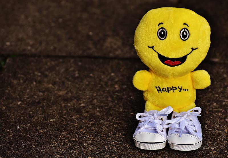 Selective focus of yellow emoji plush toy