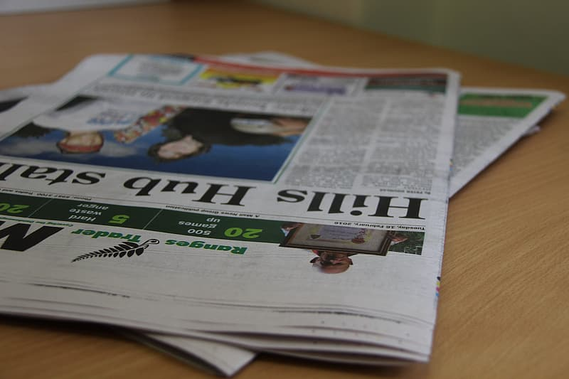Newspaper on brown wooden table