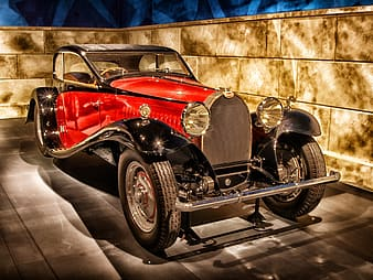 Red and black classic car scale model