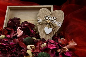 Red roses and heart shaped wooden heart shaped decor