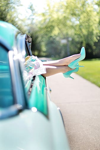Selective focus photograph of person wearing teal pump-heeled shoes