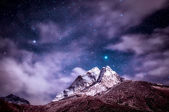 Snowy mountain during night time