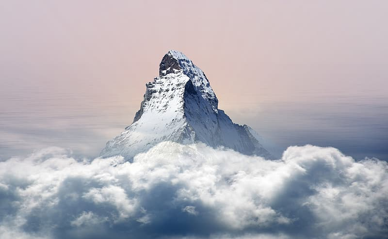 Snow-covered mountain above clouds
